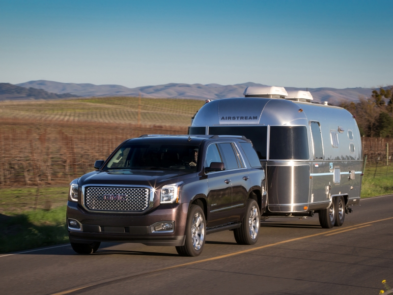 brand new yukon denali towing airstream