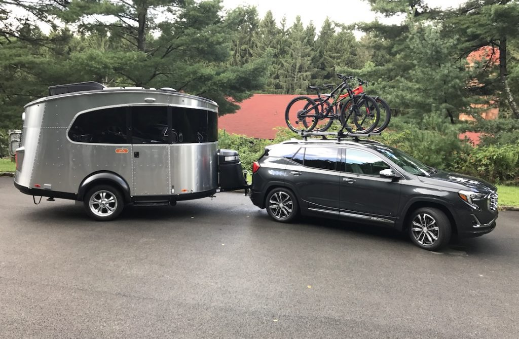 2018 gray GMC Terrain towing camper